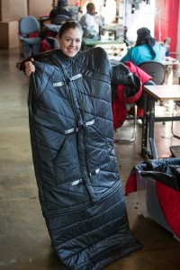 GM donates scrap materials to make coats for the homeless